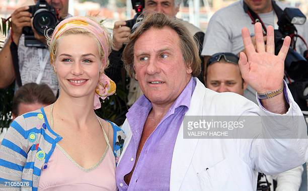 French actor Gerard Depardieu gestures next to Belgian actress Cecile de France as they pose during a photocall for French director Xavier Giannoli's...