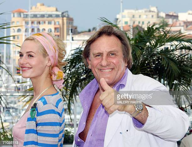French actor Gerard Depardieu gives a thumbs up as he poses with Belgian actress Cecile de France during a photocall for French director Xavier...