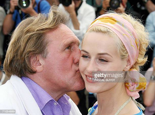 French actor Gerard Depardieu kisses Belgian actress Cecile de France during a photocall for French director Xavier Giannoli's film 'Quand j'etais...