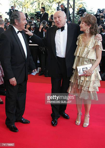 French actor/director Michel Piccoli talks to an unidentified guest as he arrives with his wife Ludivine Clerc at the Festival Palace for the...