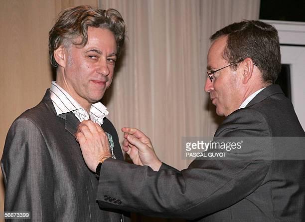 French Culture minister Renaud Donnedieu de Vabres awards Live 8 caritatives concerts organiser Bob Geldof the medal of Chevalier de l'Ordre des Arts...