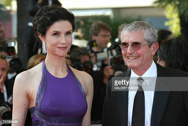 French director Claude Lelouch and his wife actress Alessandra Martines pose 19 May 2007 upon arriving at the Festival Palace in Cannes, southern...