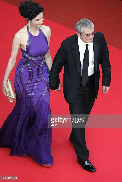 French director Claude Lelouch and his wife actress Alessandra Martines 19 May 2007 arrive at the Festival Palace in Cannes, southern France, for the...
