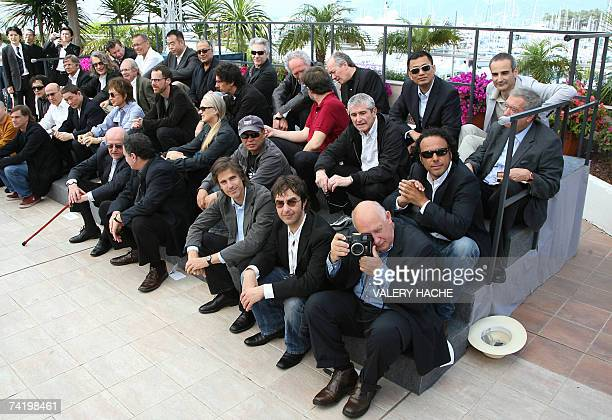 French director Raymond Depardon takes pictures 20 May 2007 as he poses with Malaysian director Tsai Ming Liang US director Gus Van Sant French...