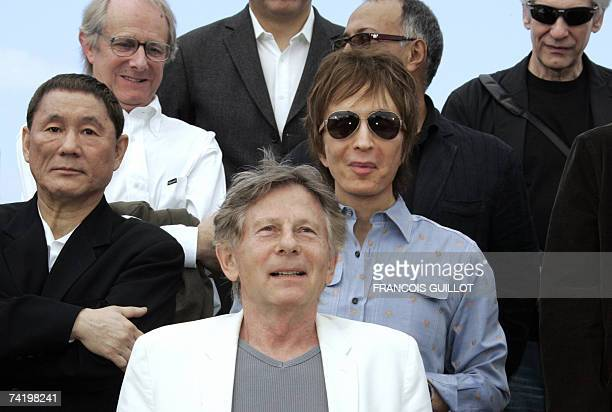 French director Roman Polanski poses 20 May 2007 with Japanese director Takeshi Kitano and US director Michael Cimino British director Ken Loach and...