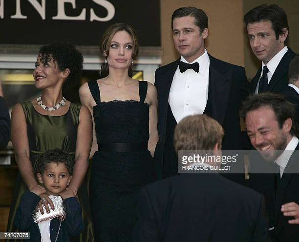 French journalist and writer Mariane Pearl and her son Adam, US actress Angelina Jolie, actor and producer Brad Pitt and actor Dan Futterman pose 21...