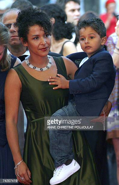 French journalist and writer Mariane Pearl arrives 21 May 2007 with her son Adam at the Festival Palace in Cannes, southern France, for the screening...