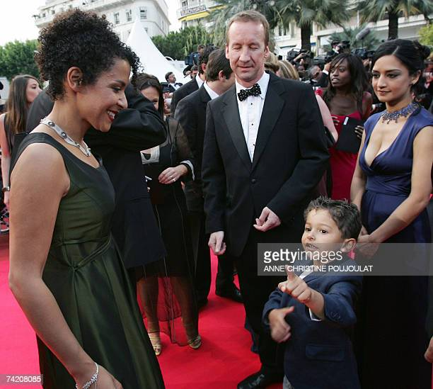 French journalist and writer Mariane Pearl listens 21 May 2007 to her son Adam, as she arrive swith British producer Andrew Eaton and actress Archie...