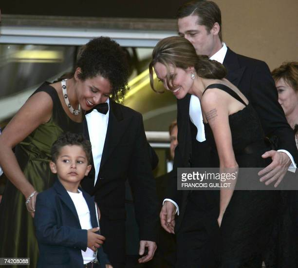 French journalist and writer Mariane Pearl smiles 21 May 2007 as she looks at her son Adam nyext to US actress Angelina Jolie and actor and producer...