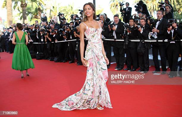 French model Noemie Lenoir poses upon arriving at the Festival Palace to attend the premiere of French director Xavier Giannoli's film 'Quand j'etais...