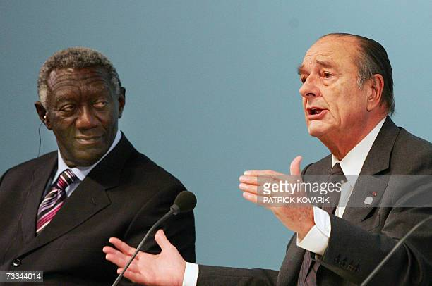 French President Jacques Chirac delivers a speech next to Ghanaian President John Agyekum Kufuor during a joint press conference at the end of the...