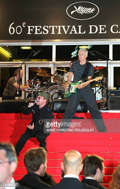 Irish rock band U2 lead singer Bono performs early 20 May 2007 with fellow band members Irish drummer Larry Mullen and British bass player Adam...