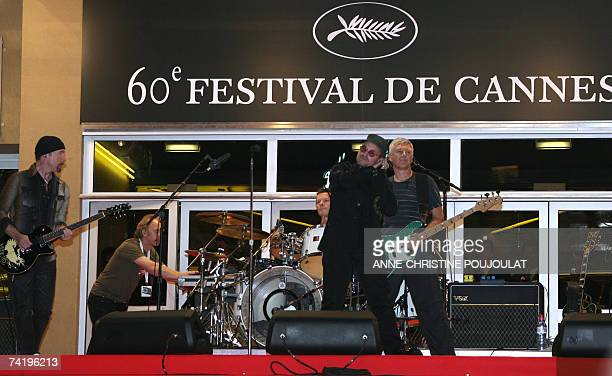 Irish rock band U2 lead singer Bono performs early 20 May 2007 with fellow band members British guitar player The Edge Irish drummer Larry Mullen and...