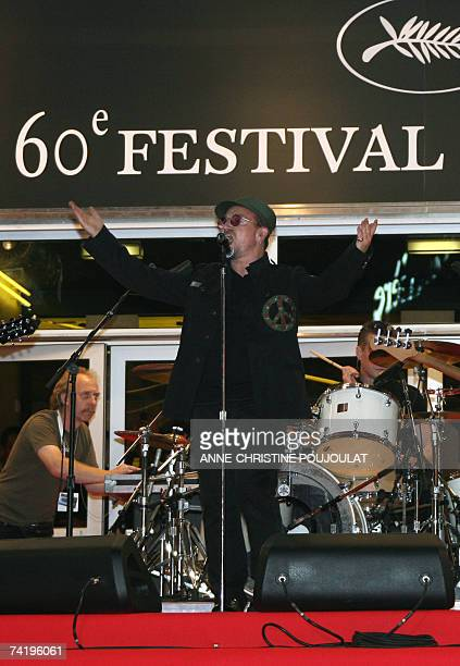 Irish rock band U2's lead singer Bono performs early 20 May 2007 with fellow band member Irish drummer Larry Mullen on the red carpet at the Festival...