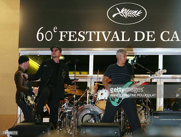 Irish rock band U2's lead singer Bono performs early 20 May 2007 with fellow band members British guitar player The Edge Irish drummer Larry Mullen...