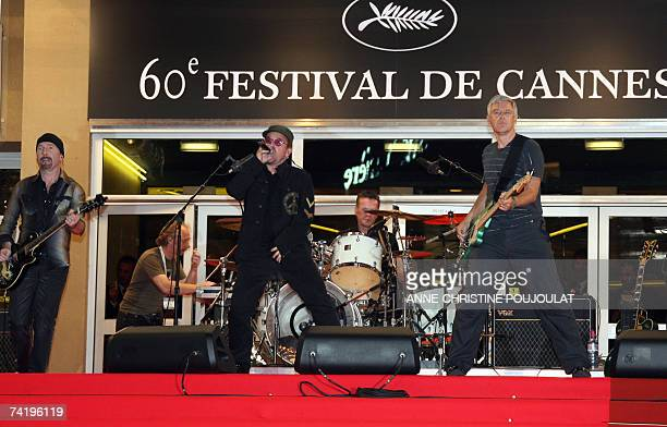 Irish rock band U2's lead singer Bono performs early 20 May 2007 with fellow band members British guitar player The Edge British bass player Adam...
