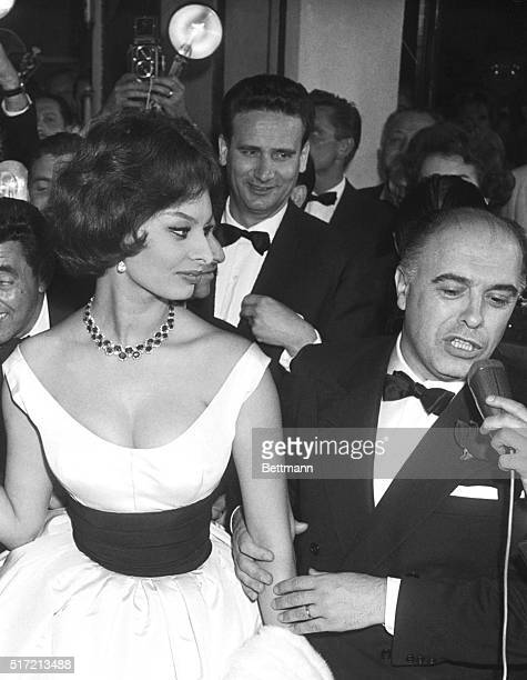 5/15/1959 Cannes France Italian actress Sophia Loren and her husband producer Carlo Ponti leave a theater here May 13th after viewing the Italian...
