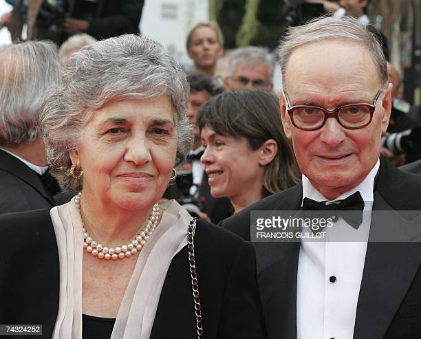 Italian composer Ennio Morricone and his wife Maria Travia pose 25 May 2007 upon arriving at the Festival Palace in Cannes southern France for the...
