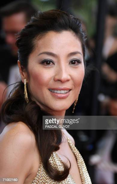 Malaysian actress Michelle Yeoh poses upon arriving at the Festival Palace for the premiere of US directors Tim Johnson and Karey Kirkpatrick's...