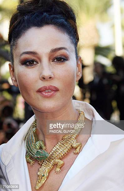Member of the Jury Italian actress Monica Bellucci wearing a Cartier necklace poses upon arriving at the Festival Palace for the premiere of French...