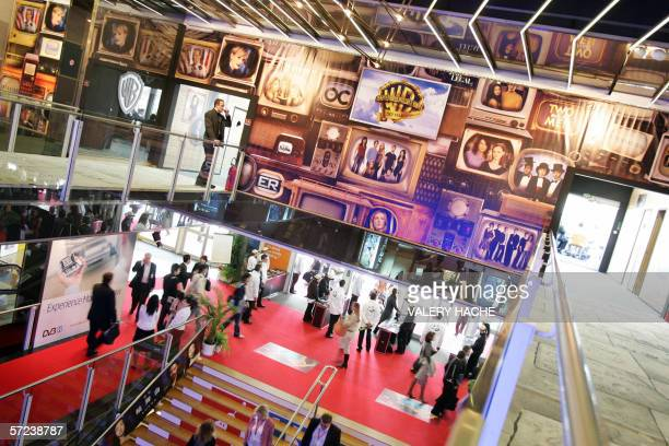People visit the annual MIPTV trade show on its opening day 03 April 2006 in Cannes Most of the big names of the Internet telecoms video and new...