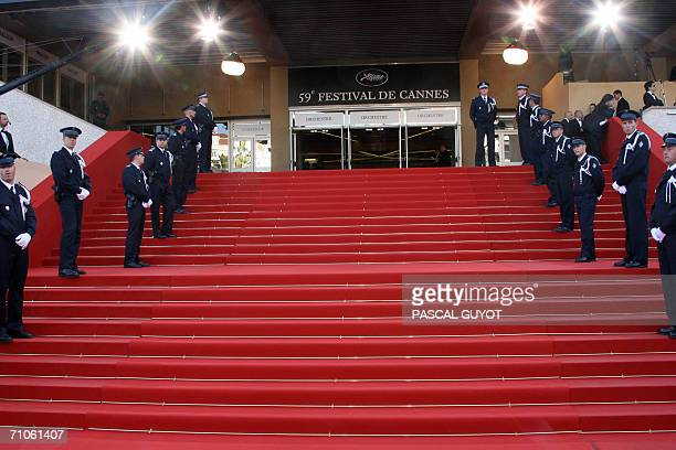 Policemen stand guard at the Festival Palace prior to the premiere of French director Xavier Giannoli's film 'Quand j'etais chanteur' at the 59th...