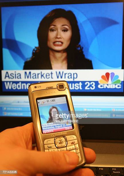 "La television mobile cherche ses marques au MIPCOM"" A mobile phone displays a TV image, 11 October 2006 in Cannes, southern France, during the 41st..."