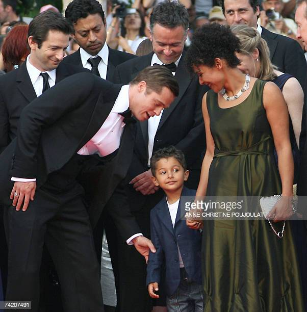 US actor and producer Brad Pitt talks 21 May 2007 to Adam Pearl son of murdered journalist Daniel Pearl next to French journalist and writer Mariane...