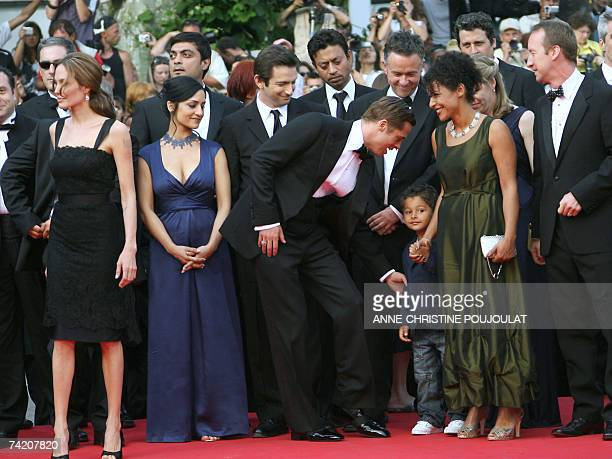 Actor and producer Brad Pitt talks 21 May 2007 to Adam Pearl, son of murdered journalist Daniel Pearl, as he arrives with US actress Angelina Jolie,...