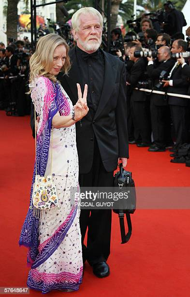 US actor Nick Nolte and guest pose upon arriving at the Festival Palace for the screening of the film 'Paris je t'aime' at the 59th edition of the...
