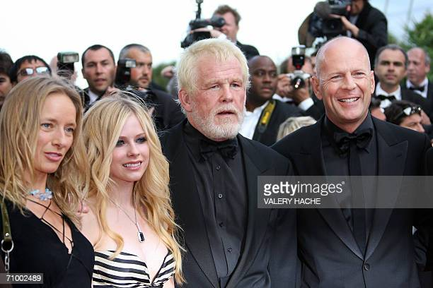 US actors Bruce Willis and Nick Nolte poses with Canadian singer/actress Avril Lavigne and a guest upon arriving at the Festival Palace for the...
