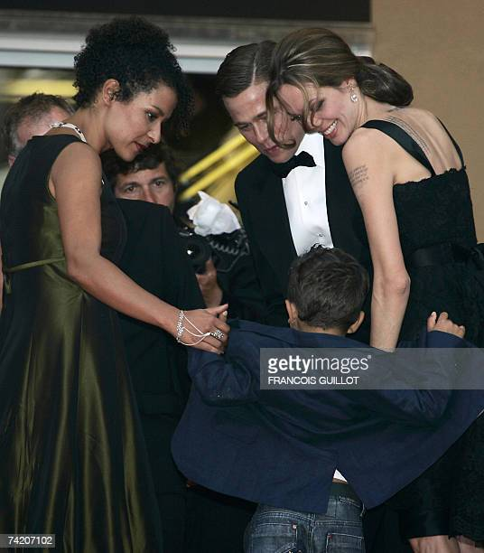 Actress Angelina Jolie and actor and producer Brad Pitt play 21 May 2007 with French journalist and writer Mariane Pearl's son Adam as they arrive at...