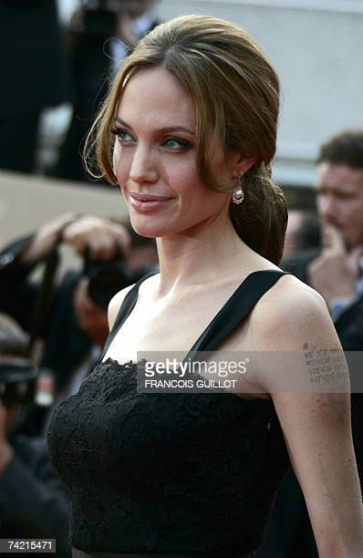 US actress Angelina Jolie poses 21 May 2007 upon arriving at the Festival Palace in Cannes southern France for the screening of British director...