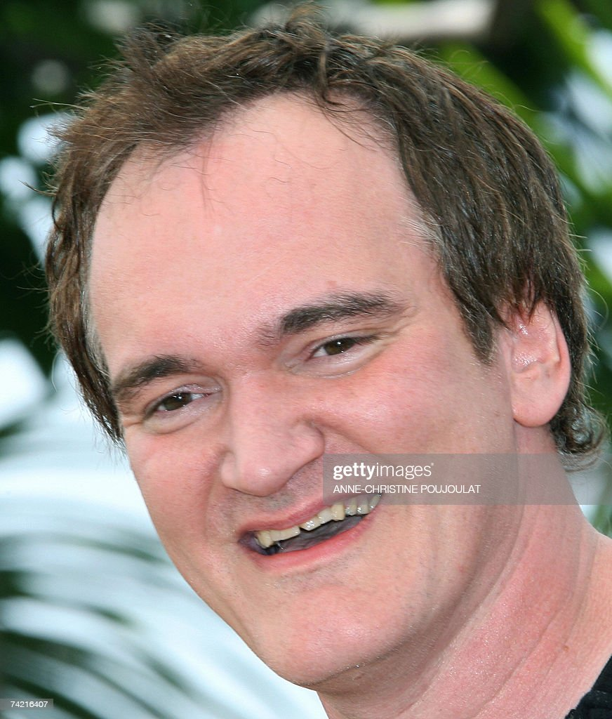 US director Quentin Tarantino poses 22 May 2007 during a photcall for his film 'Death proof' in the Festival Palace in Cannes, southern France, at the 60th edition of the Cannes Film Festival. The film is in competition for the Palme d'Or film prize. A lavish sprinkle of Hollywood stars and veteran film-makers, a dash of arthouse fare and new international discoveries -- the Cannes filmfest celebrates its 60th edition with a tried and true recipe for success.