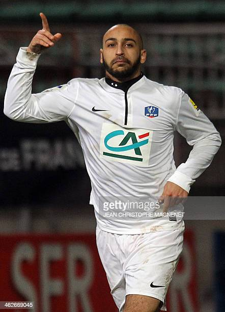 Cannes' French defender Lucas Rouabah celebrates after his team won the French Cup football match against SaintEtienne at the Coubertin Stadium in...