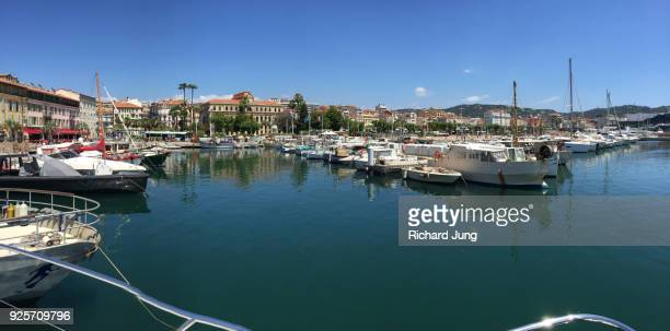 cannes harbour panoramic from boat looking towards city - コートダジュール ストックフォトと画像