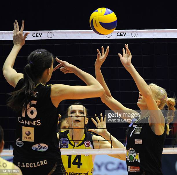 RC Cannes' Milena Rasic and Ana Antonijevic spike the ball as Fenerbahce Universal Istanbul's Eda Erdem Dundar reacts during their final four of the...