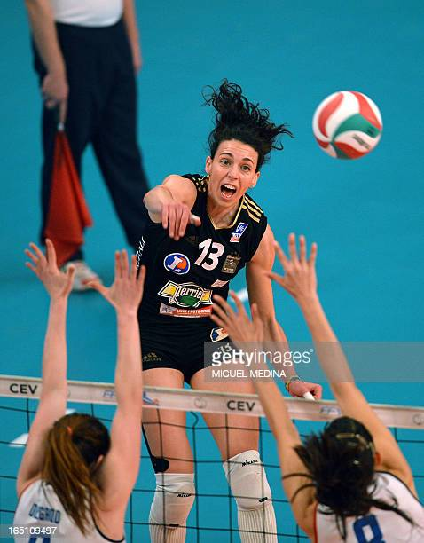 Cannes' Nadia Centoni jumps to spike during the Women French Championship volleyball final match Cannes vs Calais on March 30 2013 at the Coubertin...