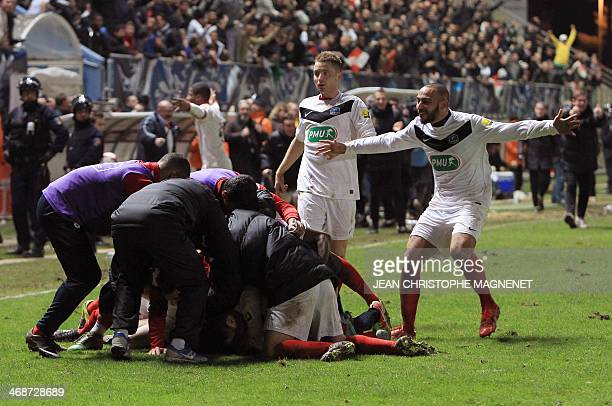 Cannes' players celebrate after Belkacem Zobiri scored a goal during the French Cup football match between Cannes and Montpellier at the Coubertin...