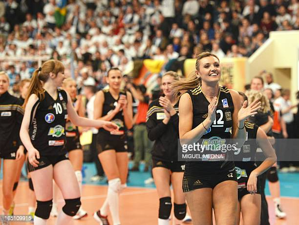 Cannes' players celebrate after winning against Calais during the French Women's Volleyball Championship final match Cannes vs Calais on March 30...