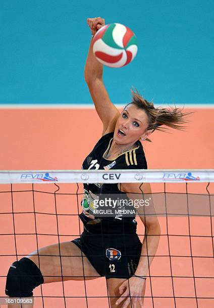 Cannes' Victoria Ravva jumps to spike during the Women French Championship volleyball final match Cannes vs Calais on March 30 2013 at the Coubertin...