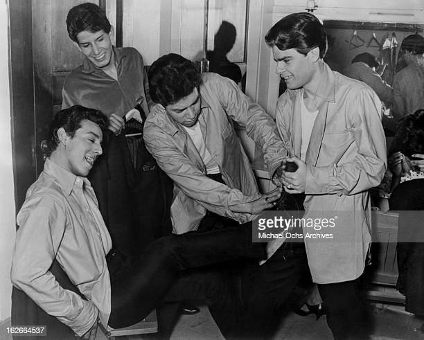 Cannibal the Headhunters get ready in their dressing room at The Shrine Auditorium circa 1965 in Los Angeles California