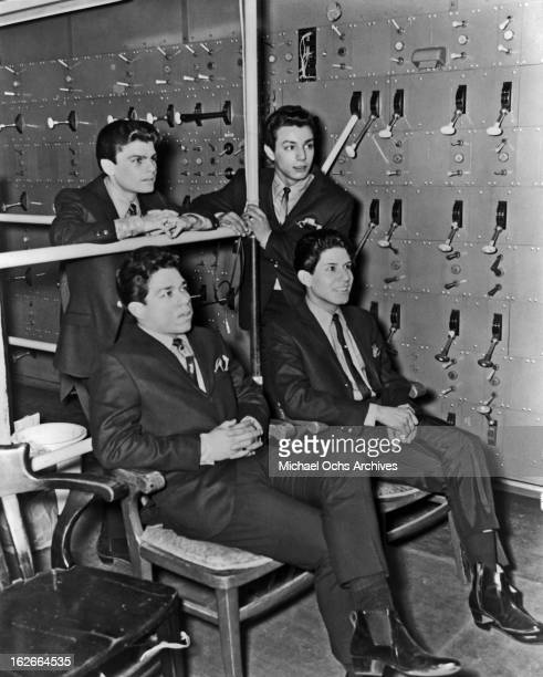 Cannibal the Headhunters pose for a portrait backstage at The Shrine Auditorium circa 1965 in Los Angeles California