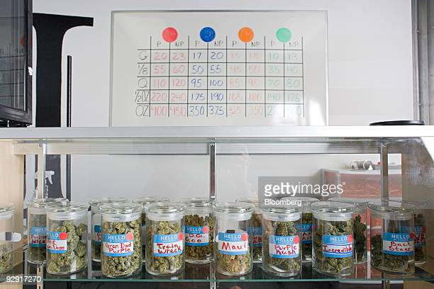 Cannisters of medical marijuana and a price list for the marijuana products is seen inside Highland Health medical dispensary and wellness center in...