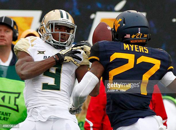 Cannon of the Baylor Bears attempts to make a catch during the game against the West Virginia Mountaineers on October 18 2014 at Mountaineer Field in...