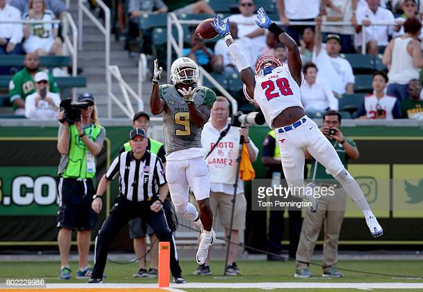 Cannon of the Baylor Bears pulls in a touchdown pass against Christian Davis of the Southern Methodist Mustangs in the second half at McLane Stadium...