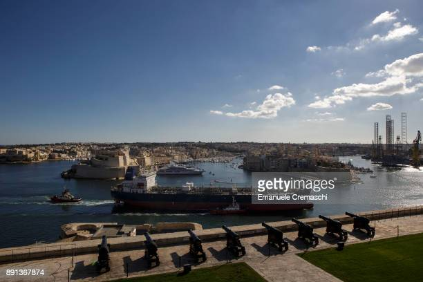 A cannon saluting battery overlooks the oil products tanker SCF Amur sailing in the Grand Harbour on December 7 2017 in Valletta Malta Valletta a...