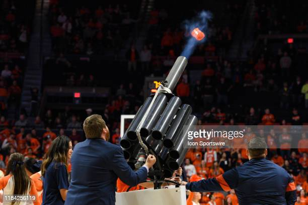 Cannon shoots t-shirts into the crowd during a college basketball game between the Hawaii Rainbow Warriors and Illinois Fighting Illini on November...