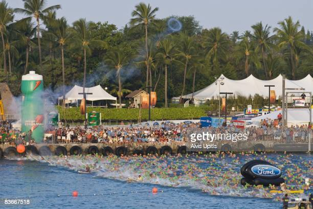Cannon signals swim start of Ford Ironman Triathlon in Kailua Bay Hawaii on October 11 2008