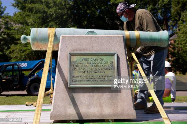 Cannon statue memorializing the US Confederacy is removed from Monument Avenue in Richmond, Virginia on July 2, 2020. - Two cannons and a figure...